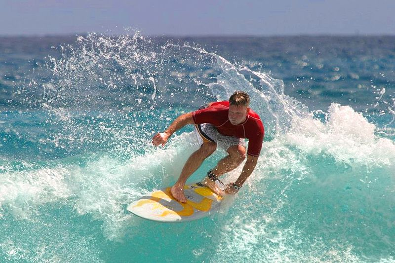 A surfer rides the waves